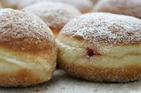 Krapfen (Carnival fritters, donuts, made with yeast, flavored with lemon zest and rum)