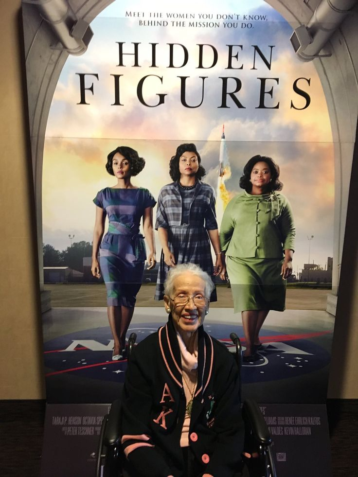 """Katherine Johnson age 98 poses in front of Movie Poster """"Hidden Figures"""" honoring her Mathematical Genius skills working at NASA. She was instrumental in helping the astronauts Moon Landing. She is portrayed in the film by Taraji P. Henson center, Janelle Monae left and Octavia Spencer on the right ⭐️⭐️⭐️⭐️"""