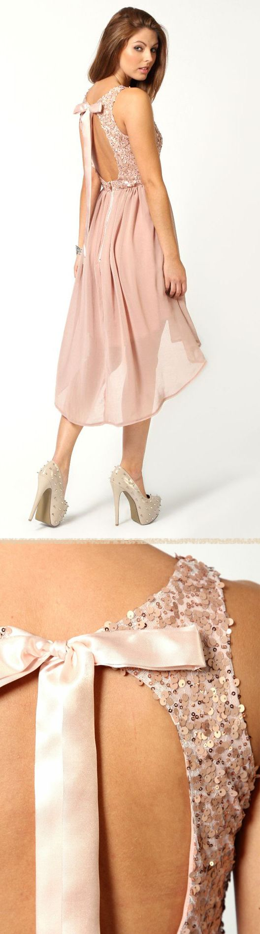 "pale pink ""going out"" dress with sequins and a satin bow in the back!"