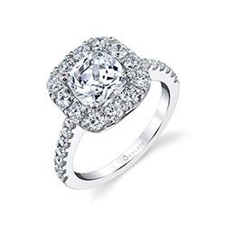 An exquisite halo of shimmering diamonds creates the setting for a dazzling 2 carat cushion cut diamond center.  The crown is set high on the elegant band of flowing diamonds and with a total of 1.06 carats, the visual effect of this engagement ring is stunning.