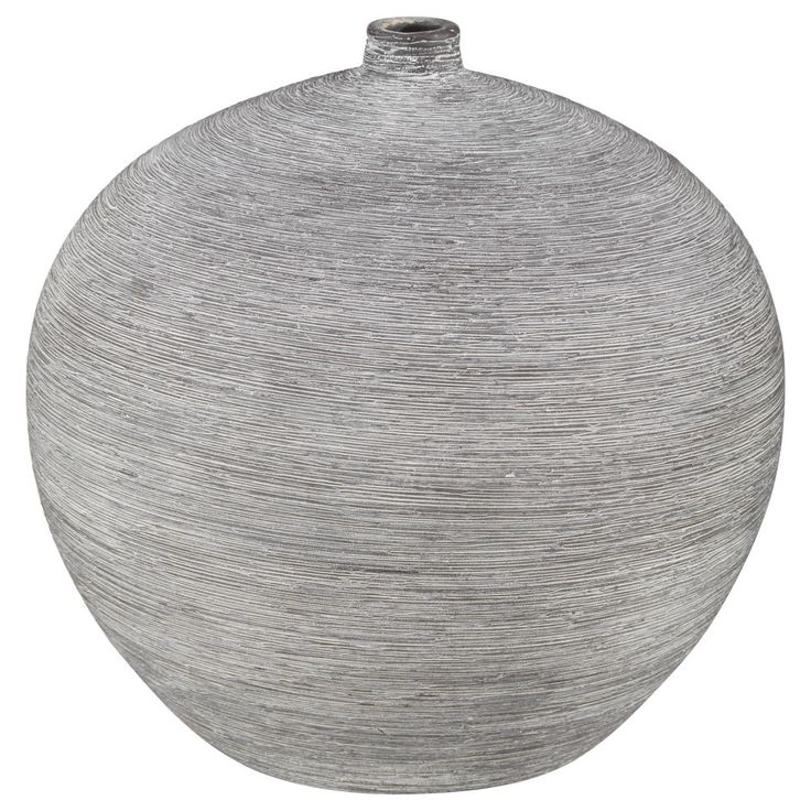 Looking to add a touch of modern style to your space? This round ceramic vase will do just that! Featuring a cool grey finish, this vessel has loads of minimalist edge. The perfect piece for so many different styles of interiors, it's a sure-fire way to give your home an instant update. Fill it with your favourite blooms, leave it empty or imagine up new and interesting uses for it. Any way you display it, you're sure to make a cool impact.