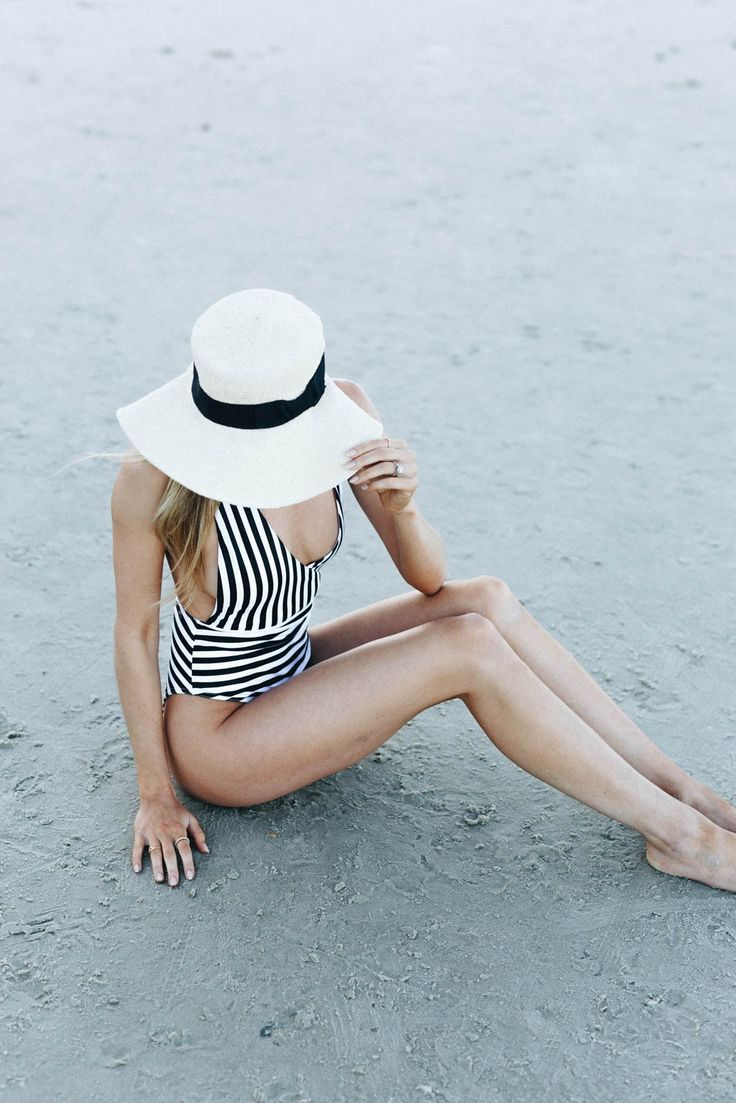 Swimwear and sun hats on West of Felicity. Loving this classic striped one piece and boater hat combo! #onepiece #stipes #sunhat #swimwear #vaction