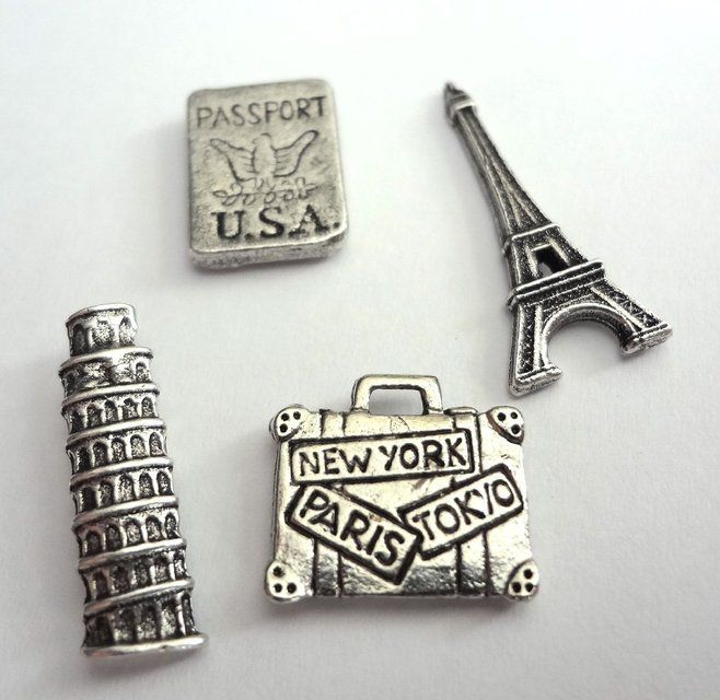 """These decorative Antique Silver Travel Push Pins will add a nice touch to your home, office, or bulletin board. All pieces come in a reusable round plastic container. Each is approx. 1/2"""" x 1"""" and has a push pin tack on the back. Set of 4 pins Please allow 3-7 days for delivery."""