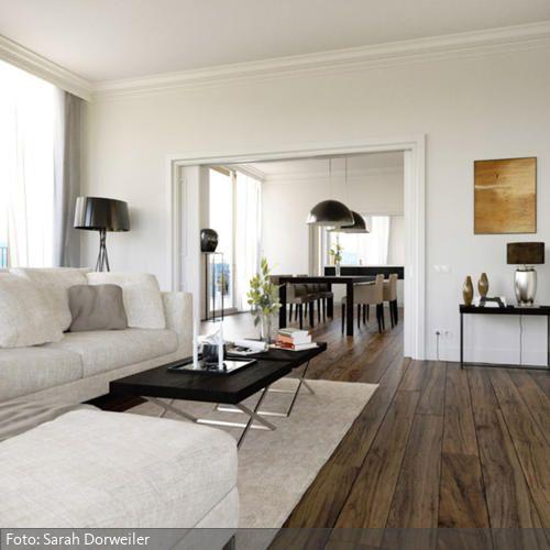 Neugestaltung einer Penthousewohnung mit großem Wohn-Essbereich, nur getrennt über eine große Schiebetür.