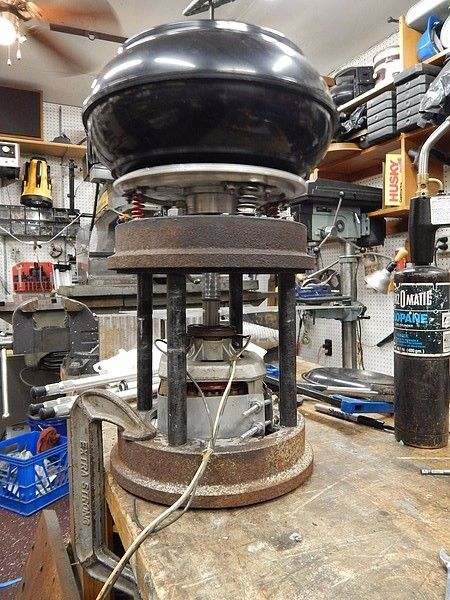 Vibratory Tumbler by Jake von Slatt -- Homemade vibratory tumbler constructed from a surplus aluminum plate, brake drums, springs, bar stock, and a dryer motor. http://www.homemadetools.net/homemade-vibratory-tumbler-5