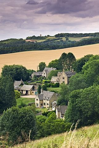 Overlooking the Cotswolds village of Snowshill, with Broadway Tower on the horizon, Worcestershire, England