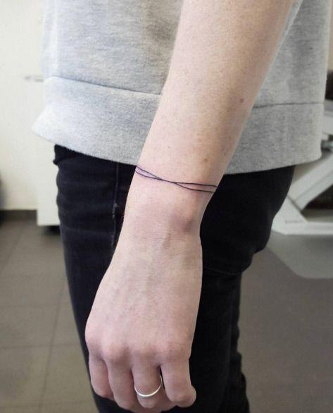 Simple Strands Bracelet Tattoo by Kristin Kippi