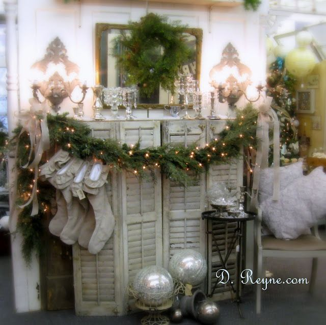 Carolers Displayed On A Mantle With Garland And Stockings: Use Shutters To Cover Ugly Fire Place. Drape Seasonal