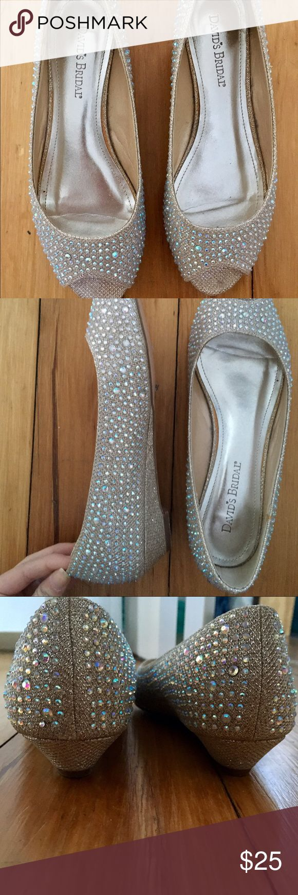 Size 8 David's Bridal sparkly flats David's Bridal. Size 8. Silver sparkles with a hint of gold. Worn once. Light scuffing on bottom of shoes (soles). Otherwise in perfect condition. Terrific for a formal dance or special occasion. David's Bridal Shoes Flats & Loafers