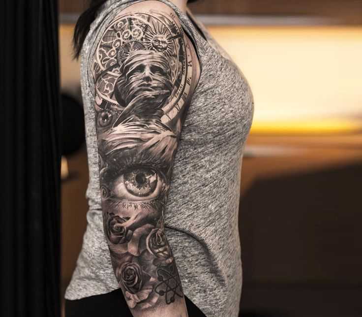 black and grey sleeve tattoo by niki norberg