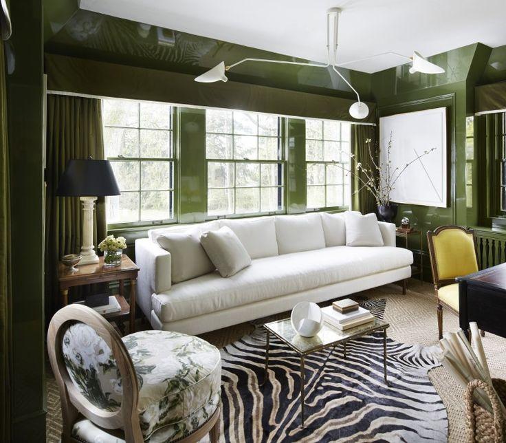 green laquered walls, zebra rug, contermporary lighting