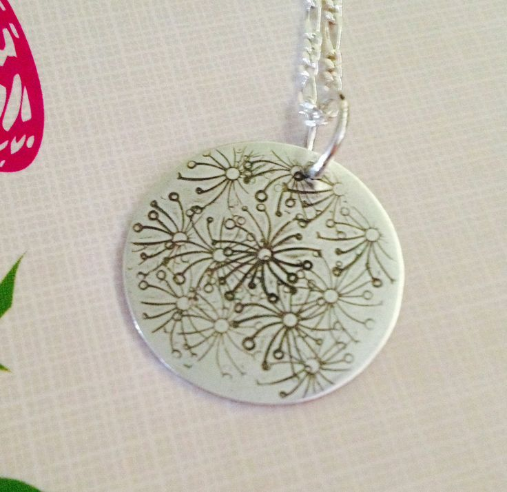 Hand stamped sterling silver daisy pendant.