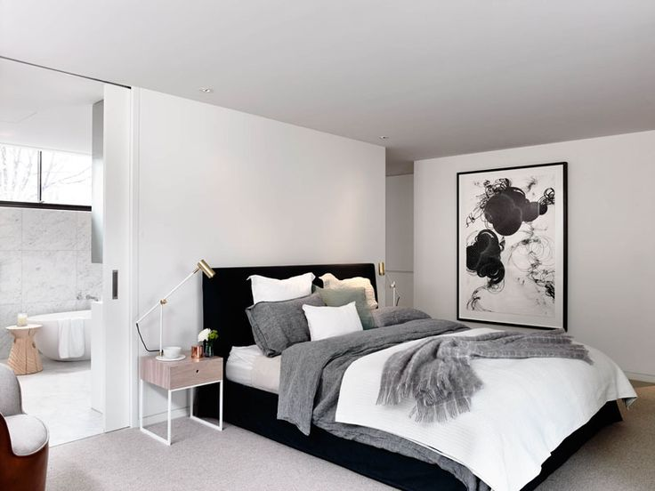 Bedroom Design Idea - 7 Ways To Create A Warm And Cozy Bedroom // Adding pieces of art to your bedroom is another way to warm up the space and make it feel more personal.