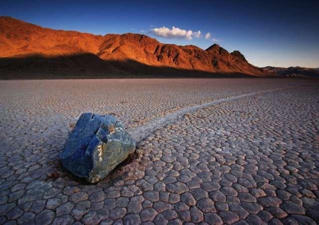 The mysterious Sailing Stones of California's Racetrack Playa. These stones move all on their own, along a smooth valley floor. Scientists have studied them and have varied theories as to why and how they're able to do this. Most of the stone's tracks develop over several years, some stones actually turn over, some rocks may move uniformly together and then alter direction.