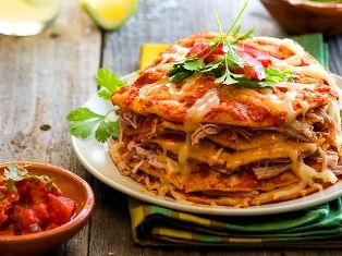 """Chipotle Kalua Pork Stacked Enchiladas Our family likes to """"stack"""" or layer our enchiladas instead of the traditional rolled and baked. The..."""