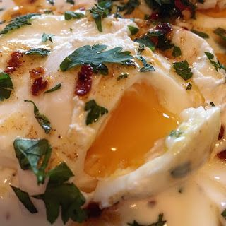 It might seem a bit strange to be called Turkish eggs when it uses Greek yogurt but I don't really care. All I care about is knowing that yogurt, eggs, garlic, herbs and chili oil can all work together to create a brilliant breakfast (or lunch!) time dish that I'll be honest, I was hesitant to try but can now confirmation is delicious. Who'd of thought it eh?