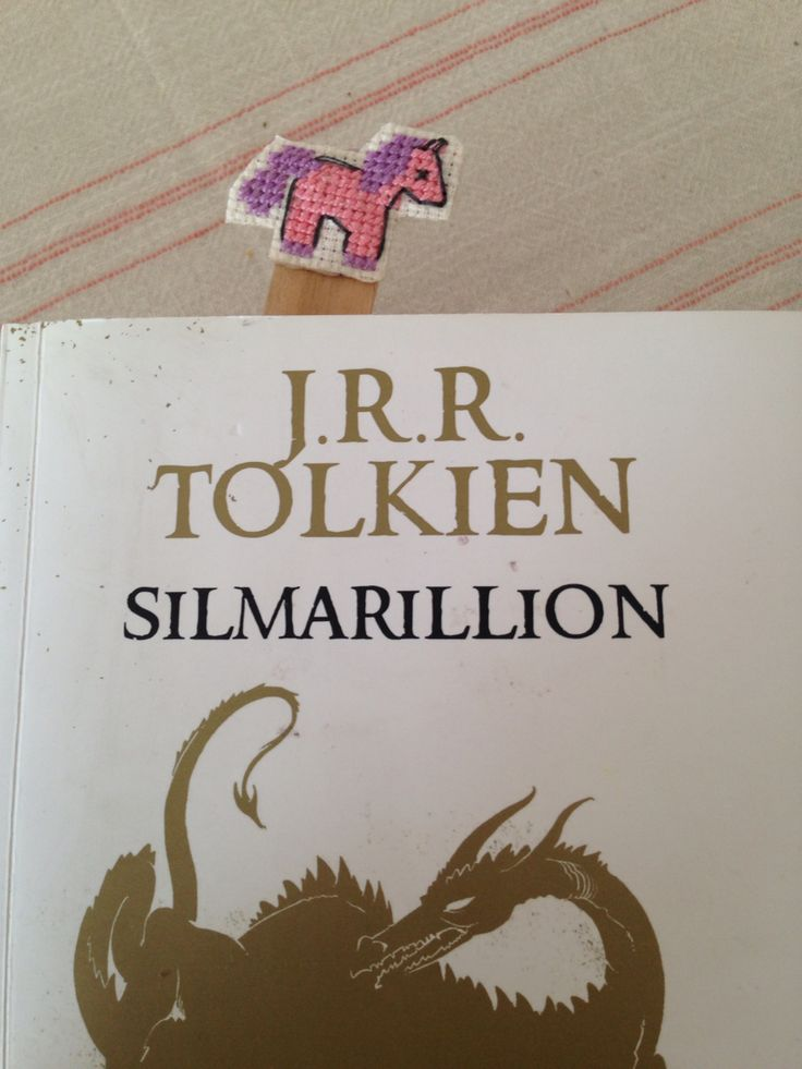 Little pink unicorn with its book cross stitch