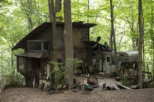 """outsiders2-1 The exteriors of the shacks where """"Outsiders"""" character Big Foster (David Morse, """"Treme"""") resides were built in the woods of Henry Kaufmann Family Park in Monroeville. The interiors of the same building have been constructed on soundstages at 31st Street Studios in the Strip District."""