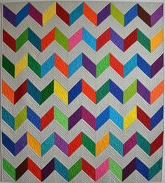 Want to whip up a stylish graphic quilt in a hurry? Make this easy chevron quilt in 6 simple steps!