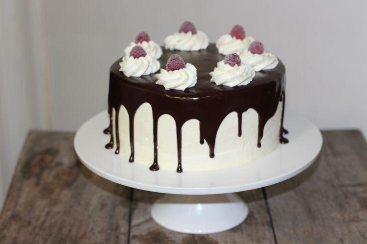 Dark chocolate raspberry cake with vanilla buttercream and dark chocolate ganache