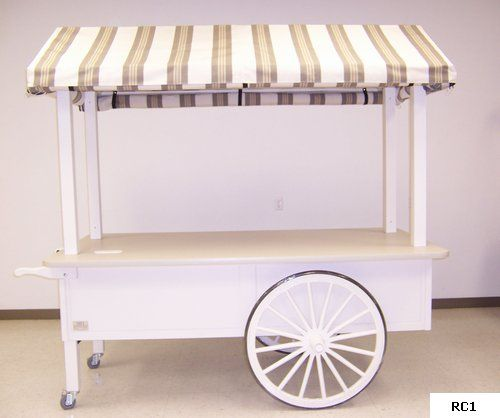 Custom mobile retail wagon wheeled vending pushcart features ample merchandising space, canvas canopy and optional canvas security panels. Build to order at http://www.mfi4u.com