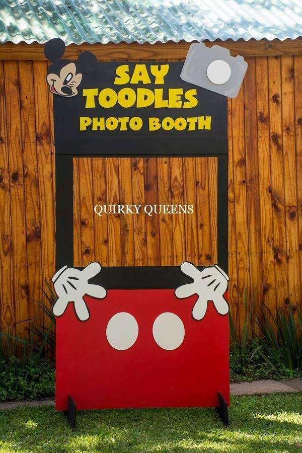 Fun photo booth at a Minnie and Mickey birthday party! See more party planning ideas at CatchMyParty.com!