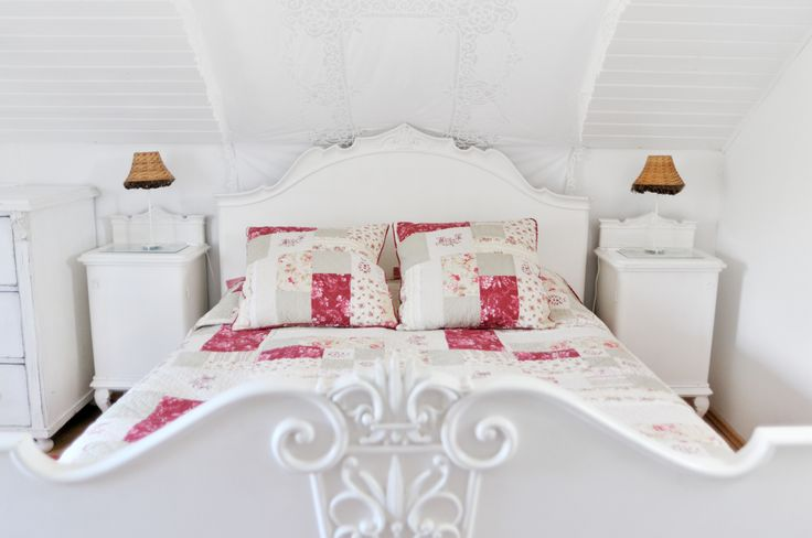 Upstairs king-size bed at The Nest at Catherine's Vineyard Cottages in Csákberény, Hungary.