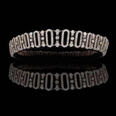 an Edwardian diamond tiara that belonged to the Spencer family. It was given to Lady Delia Spencer, great aunt to Princess Diana, by her father the 6th Earl Spencer, on her wedding day on February 18, 1914. Set with more than 800 old cut diamonds, estimated to weigh a total of 48 carats, the tiara can be transformed into a choker necklace and bracelet. Jewelry News Network: TEFAF Maastricht's High Jewelry Preview