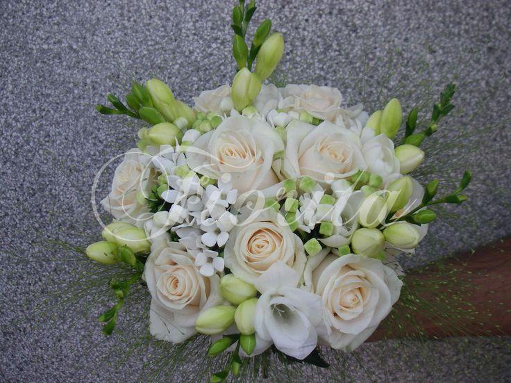 A bride's bouquet of roses, fresias eustomas and bouvadia