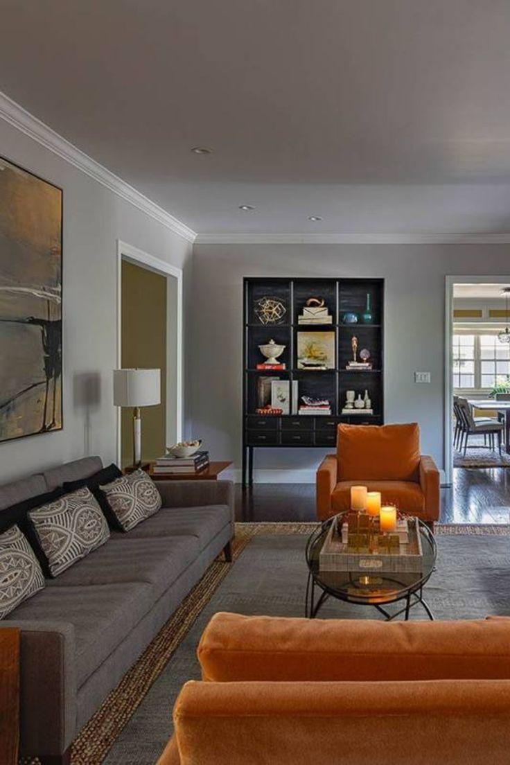 Modern mod living room with orange accent chairs and gray