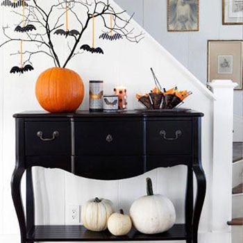 Halloween entry table. Image via Good Housekeeping: Halloween Decorations, Bats, Halloween Trees, Holidays, Halloweendecor, Halloween Fal, White Pumpkin, Branches, Halloween Ideas