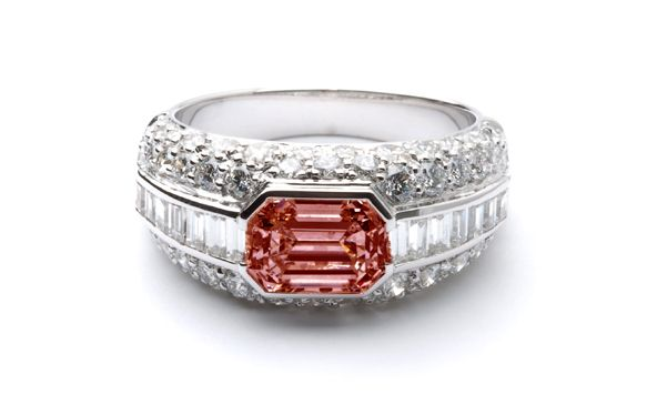 Burgundy Emerald-cut Diamond on an exceptional Engagement Ring