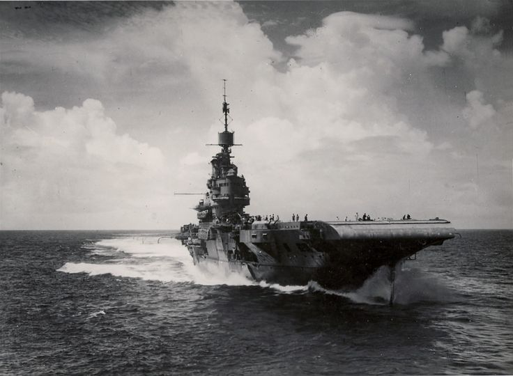 The British Royal Navy aircraft carrier HMS Illustrious (87) at sea in the Indian Ocean between 27 March and 18 May 1944, while operating with the U.S. Navy carrier USS Saratoga (CV-3).