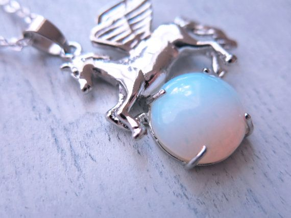 The Opalite Pegasus Necklace features a large opalite crystal cabochon caressed by a beautiful silver pegasus. Opalites are great for the crown