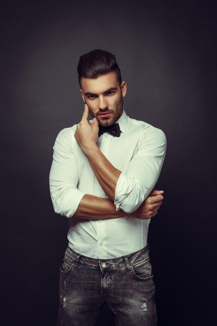 Man's Beauty - Handsome man posing in studio on dark background