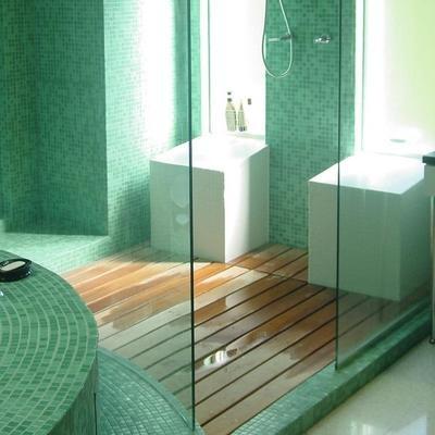 pretty tile but really liking the teak shower floor idea