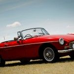 """MGB Think """"British roadster"""" and the MGB will be the first thing to spring to mind. When it replaced the MGA in 1962, it defined the small sports car segment for a generation. It originally started with a whiny little four-cylinder engine, but eventually housed an inline-six and later a loping V8. But lightweight, drop-top fun wasn't the MGB's only contribution: it was the first vehicle to feature crumple zones. And it inspired the Japanese to create the Miata.  Photo: Pyntofmyld/Flickr"""