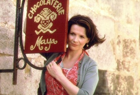 'Chocolat': A sleepy 1950's French town gets a bit of spice when a mysterious woman opens a chocolaterie during lent. Lots of wonderful chocolate making (and eating) scenes.  Juliette Binoche as the chocolatier single mother, Judy Dench as a curmudgeonly yet lovable old woman & Johnny Depp as an Irish gypsy (and yes, his accent is exceedingly good).