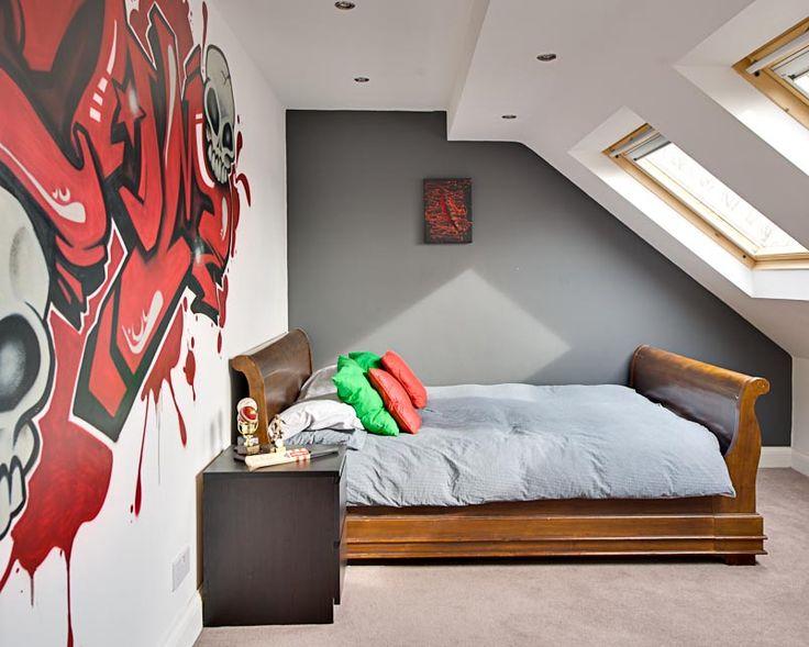 Teenage Boys' Bedroom With A Graffiti Wall.