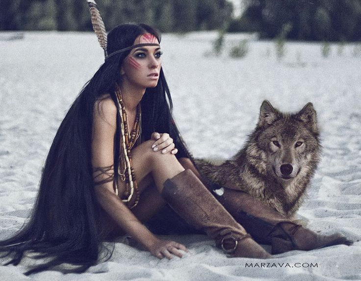 I love this pic so much! I look a bit like her, skinny with really long hair..... I'd really love to sit on the beach in that outfit with my wolf and my warpaint!
