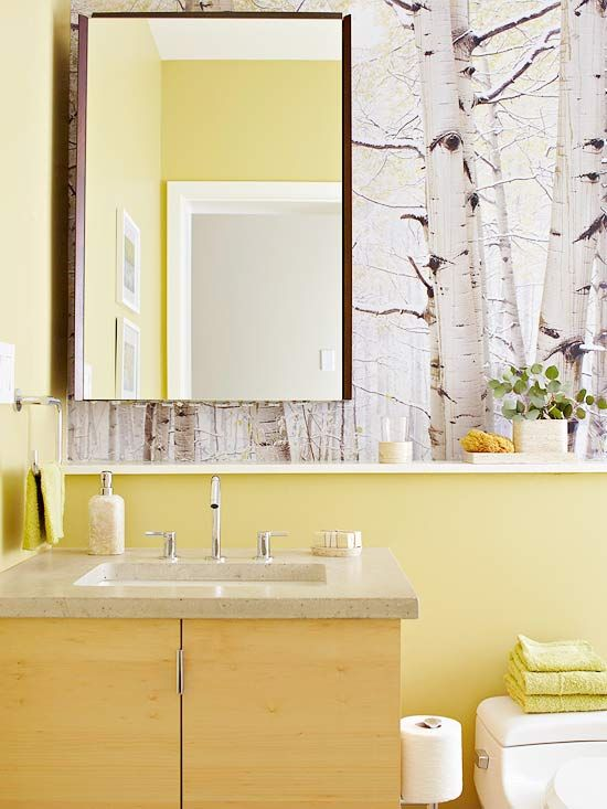 I love the sunny outdoor feel of this bathroom. The beautiful white birch (or aspen) wallpaper is so popular now.