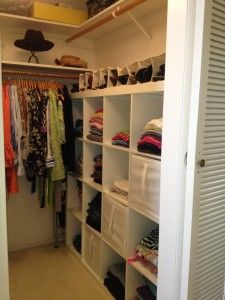 editorganizing.com  Walk In Closet.  Traditional shelves and wood bars work with an ikea cube system for folded shirts, trousers etc.  By removing a big dresser with drawers, this closet is more functional and efficient.