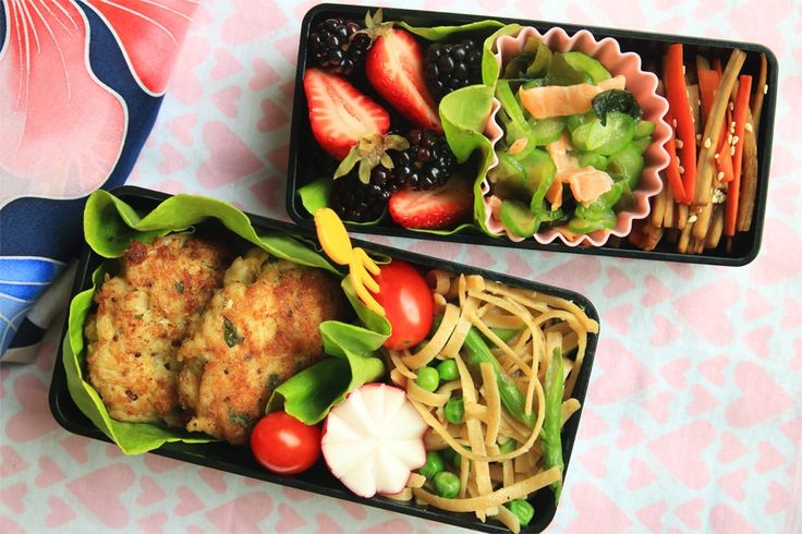 Michellane's pasta bento. One of our TOP 20 Finalists. USA.  This colorful springtime bento features linguine with asparagus and peas.  The crab cakes were made according to my grandmother's recipe using local Maryland crab.  The Just Bento cookbook provided inspiration for the radish tulip and the smoked salmon, wakame, and cucumber salad.  My mother taught me her technique for kinpira gobo, which makes a regular appearance in my bento.