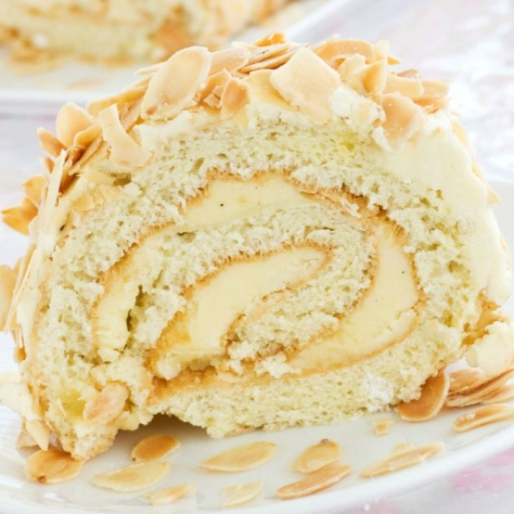 A delicous light and fluffy almond sponge cake rolled around a delightful creamy white chocolate filling.. White Chocolate Almond Yule Log Recipe from Grandmothers Kitchen.