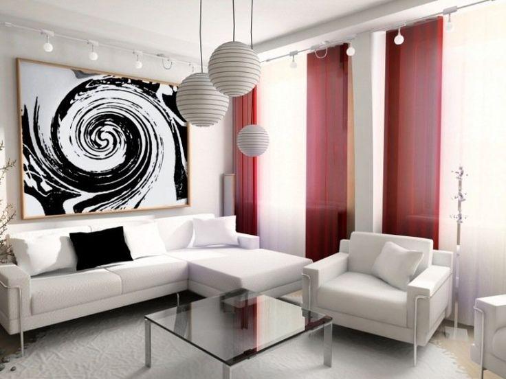 salon blanc avec canapé, fauteuils et suspensions boules en blanc, table basse en verre et rideaux rouges comme accent