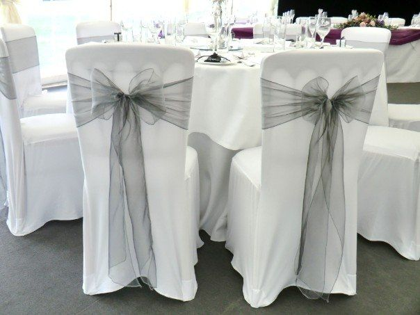 Love the silver bows, loose all the white seat covers. Love this with a white silver and peach/pink color scheme!
