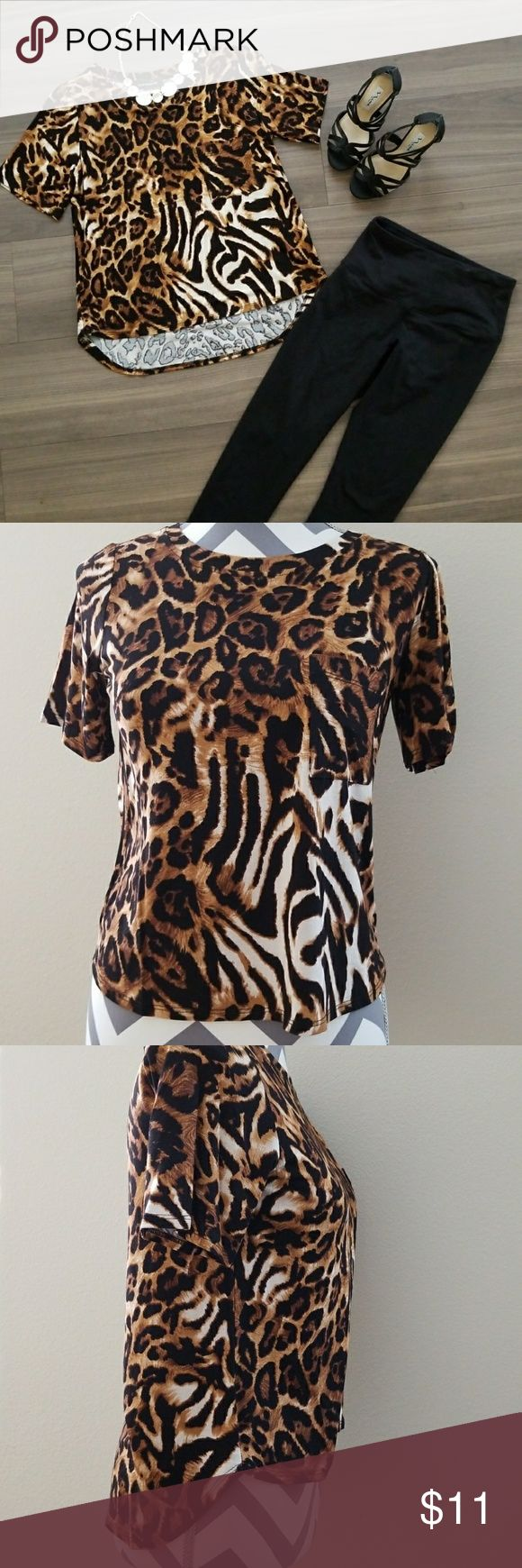 Cheetah print shirt. Never been worn. Cheers print top with a pocket.  FABRIC:  95% Rayon  5% Spandex  Dry clean only. Hourglass Lily Tops
