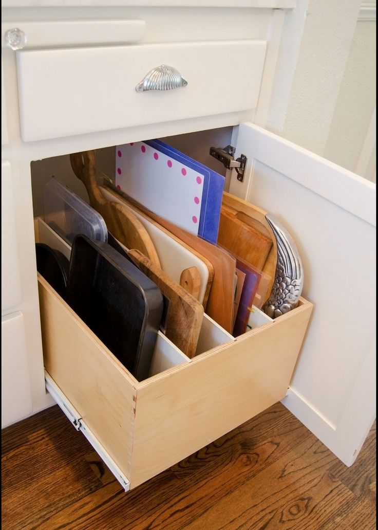 Love this storage area for trays.