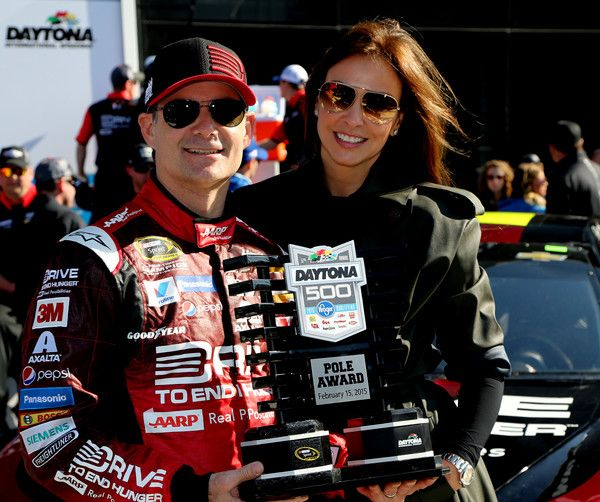 Jeff Gordon | Jeff Gordon, driver of the #24 Drive To End Hunger Chevrolet, and his wife, Ingrid Vandebosch, pose with the Daytona 500 Pole Award after qualifying for the pole position for the 57th Annual Daytona 500 at Daytona International Speedway on February 15, 2015 in Daytona Beach, Florida.