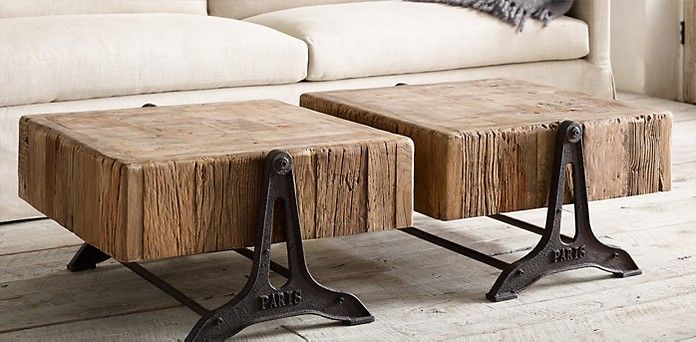 """RECLAIMED RUSSIAN PINE INDUSTRIAL COFFEE TABLE $995 Low to the ground, our substantial table is crafted of reclaimed pine from Russia. The planked top is surrounded by a worn and craggy border of dense end-grain timbers. The cast iron base suits its industrial demeanor. DIMENSIONS 32""""W x 35""""D x 21""""H"""